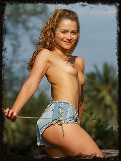 Outdoors with this country girl who smiles and glows and strips down and puts her ass up to tease you to death.