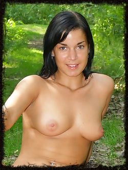 Public nudity is the word of the day with a happy girl in the park just making hikers stop in awe.