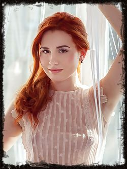 Redhead newcomer Nicole La Cray bares her alluring body and meaty ass as she poses by the window.