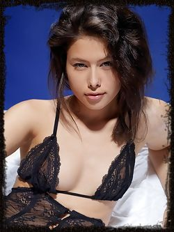 The stunning Jackie D performs a slow and sensual striptease all over the bed.
