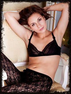 Tirata looks seductive in black lace lingerie and black lace pantyhose