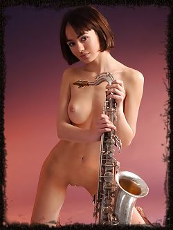 Young sweet girl loves jazz music and sexy instruments of music , she has an angel nubile body.