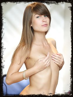 A smiling Mia D with her sparkling blue green eyes greets us as she showcase her tight, athletic body and firm assets.