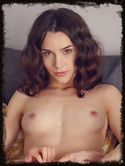 Adel Morel bares her perky nipples and yummy pussy on the sofa.