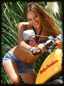Dominika A looks stunning naked on a motorcycle