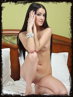 Grace B's long black hair frames her beautiful face with delicate features