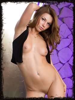 Hot and naughty, Adriana erotically strips down her pants for an all-revealing performance.
