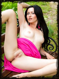 Janelle B bares her gorgeous body with puffy breasts, slim waist, and her exquisite pink pussy on top of a graden bench.