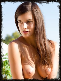 Lennox is a hot bombshell showcasing her gorgeous breasts, delicious pussy and sexy body outside the sun