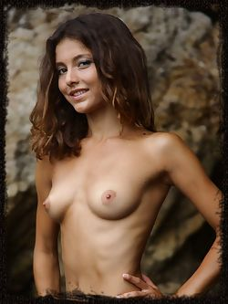 Divina A tight body with exquisite female curves and olive skintone stands out against the rough boulders