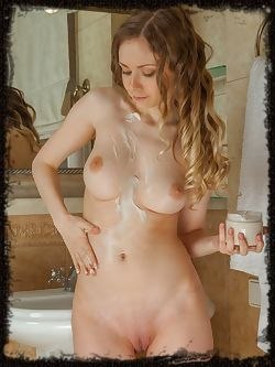 Lenore flaunts her slender, naked body with smooth pussy as she poses in the bathroom.