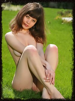 Pretty girl on the grass outside , she is a blue eyed beautiful naked lawn elf.