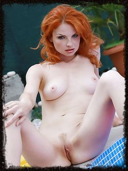 Red hair is burning hot on this model who knows how to keep it going.