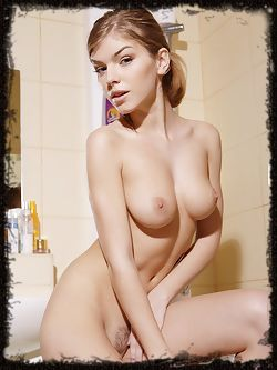 Ultra hot Inga is a petite girl with perky breasts and a young ass that gets wet in the tub.